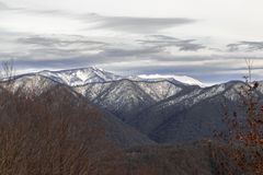 winter landscape, mountains Bolshaya Chura and Achishkho in the snow, the view from the city of Sochi stock photo