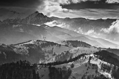 Winter landscape with mountains and clouds. Landscape with mountains and clouds in a cold day of winter stock images
