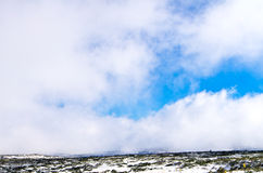 Winter landscape. In mountains with flying clouds Stock Photo