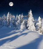 Winter landscape in the mountains with full moon. Royalty Free Stock Photos