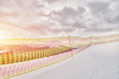 Winter landscape in the mountains, ski slope. Fencing royalty free stock images