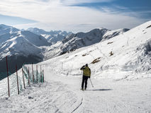 Winter landscape in the mountains and skier Stock Image