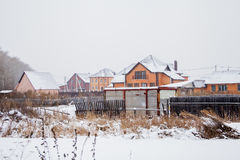 Winter landscape with new brick cottage Stock Photos