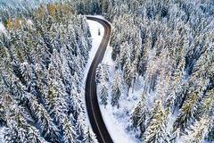New road in the winter forest. Highway view from above. stock images