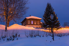 Winter landscape in the night. Buildings after sunset up North on Christmas Eve. Stock Photo