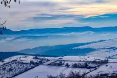 Winter landscape in Novi Pazar, Serbia. Mountains covered with snow and fog in Novi Pazar, Serbia Stock Image