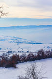 Winter landscape in Novi Pazar, Serbia. Mountains covered with snow and fog in Novi Pazar, Serbia Royalty Free Stock Photography