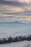 Winter landscape in Novi Pazar, Serbia. Mountains covered with snow and fog in Novi Pazar, Serbia Royalty Free Stock Image