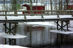 Winter landscape with old bridge and hut Royalty Free Stock Image