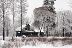 Winter landscape with an old house. Stock Image