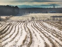 Winter landscape. A winter landscape in our countryside, a mahogany field and mountains in the distance. Nice atmosphere Royalty Free Stock Photos
