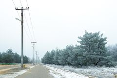 Winter landscape. Power line supports, electricity, line, column. Winter landscape. Outside the city is covered with snow. Fairy Winter. snowy city. city streets Stock Photography