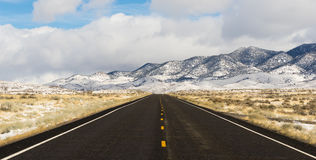 Winter Landscape Panoramic Great Basin Central Nevada Highway. Long set of snowcovered foothills and ridges along highway 50 in Nevada royalty free stock photography
