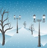 Winter landscape in a park with lanterns Royalty Free Stock Photo