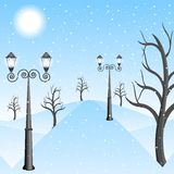 Winter landscape in a park with lanterns Stock Images