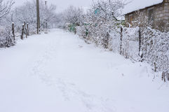 Winter landscape with path in deep snow Stock Photo