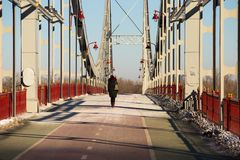 Pedestrian bridge across the river Dnieper. Winter landscape of pedestrian bridge across the river Dnieper in Kiev city Stock Photography