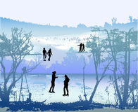Winter landscape with people skating on frozen lake. Blue, white and green landscape with silhouettes of trees and people Royalty Free Stock Image