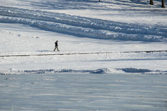 Winter landscape. People walking together across frozen lake in beautiful mountain winter landscape Stock Images