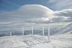 Winter Landscape, Pillars and Clouds Stock Photos