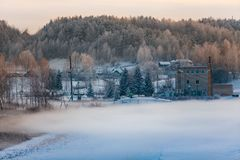 Winter landscape. Station producing electricity for small village royalty free stock images