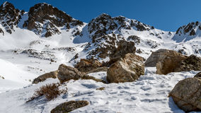 Winter landscape in Pyrenees. Stones and rocks at winter time in Pyrenees mountains Royalty Free Stock Photo