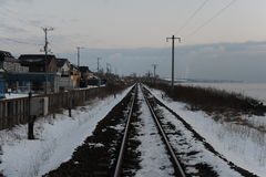Winter landscape with railroad in rural Japan Stock Images