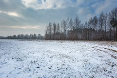 Winter landscape with raised hide and snow covered countryside. Winter landscape with snow covered countryside and raised hide. European winter landscape Stock Photo
