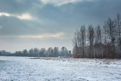 Winter landscape with raised hide and snow covered countryside. Winter landscape with snow covered countryside and raised hide. European winter landscape Stock Photography