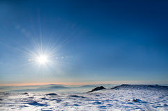 Wintry Landscape. The sun shining over a wintry landscape Royalty Free Stock Photo