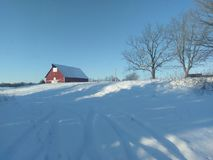 Winter landscape with red barn on western Indiana. Winter landscape with red barn on cold December day in western Indiana with pretty blue sky royalty free stock photo