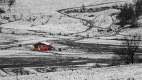 Winter landscape with red house. Black and white winter landscape with red house Royalty Free Stock Photo