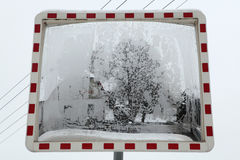 Winter landscape reflecting in the convex mirror. Stock Photography