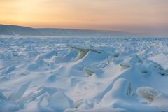 Winter landscape with ridged ice on the frozen Lena river at sunset. Winter. ridged ice on the frozen Lena river in the Natural Park Lenskie Stolby Lena Pillars stock image