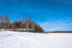 Winter landscape on the river. Stock Photos