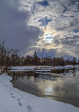 Winter landscape, the river, the dark sky Stock Photos