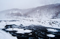 Winter landscape. The river flows through the ice and snow stock images