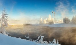 Winter landscape with river and power line, Russia, the Urals, Royalty Free Stock Photos