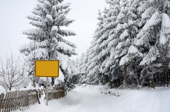 Winter landscape with road sign Royalty Free Stock Images