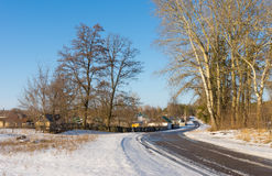 Winter landscape with road to Derevki village in Ukrainian Stock Photo