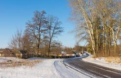 Winter landscape with road to Derevki village in Ukrainian stock photo