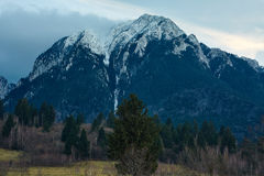 Winter landscape with rocky mountains Stock Photo