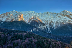 Winter landscape with rocky mountains Stock Photography