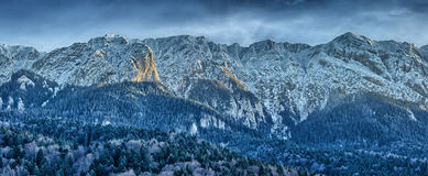 Winter landscape with rocky mountains Stock Images