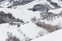 Winter Landscape. Winter rural landscape in the transylvanian village, at Holbav, Brasov Royalty Free Stock Image