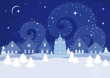 Winter landscape with Russian farmhouses and Christian church Royalty Free Stock Image