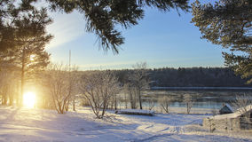 Winter landscape in Russian village during sunset. Stock Photography