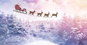 Winter landscape and Santa`s sleigh and reindeer`s. Digital composite of Winter landscape and Santa`s sleigh and reindeer`s Royalty Free Stock Photography