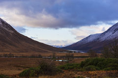 Winter landscape of Scottish nature with Glencoe mountains at Gl Royalty Free Stock Photo