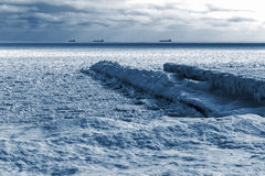 Winter landscape. Sea covered blocks of ice on the horizon are s Stock Photo